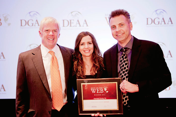 Photo showing staff accepting BOW award.